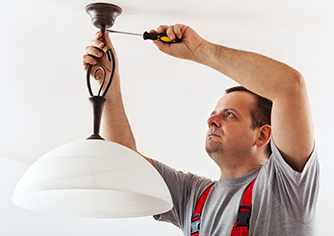 Electrician Fixing Light Fixture